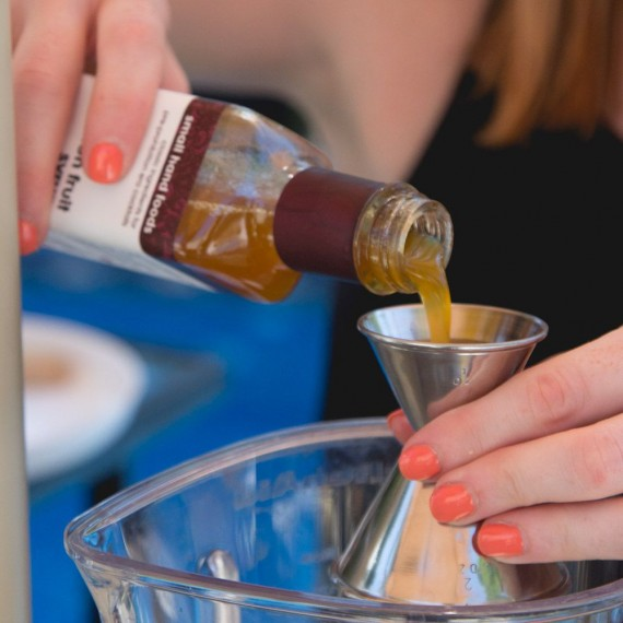 When pouring into a double jigger, it is best to pour over a glass to avoid spills onto the bar.