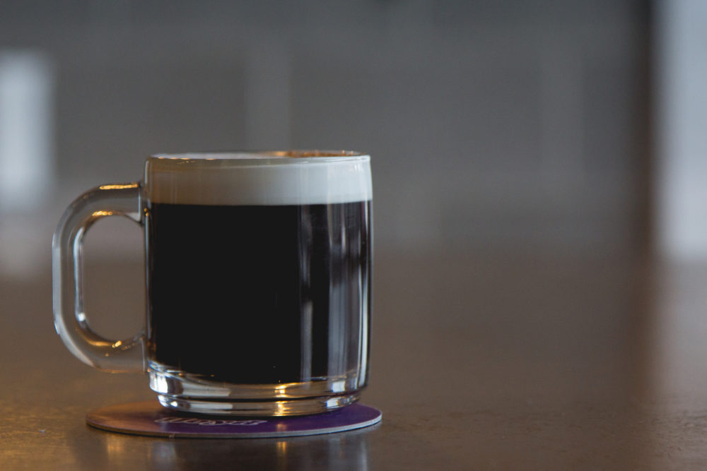 a coffee cocktail on the bar