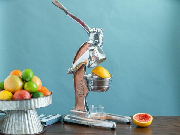 Manual juicer juicing a grapefruit