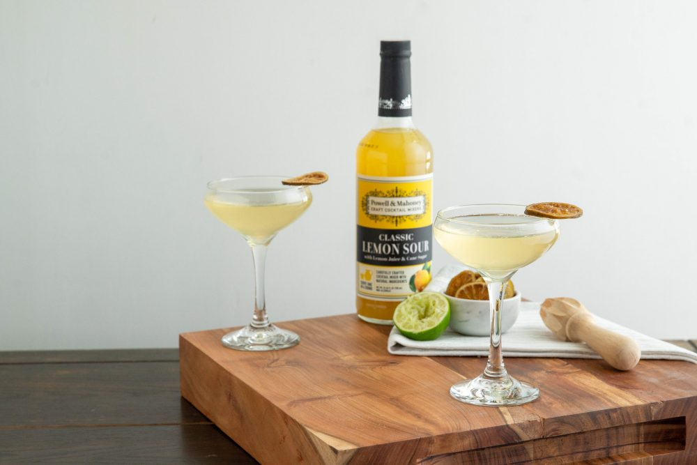 Sparkling Lemon Lime Cocktail On Cutting Board with Candied Citrus