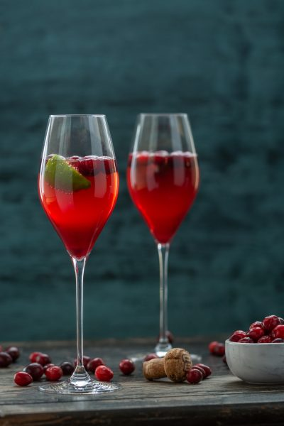Cranberry Champagne Cocktail with bowl of cranberries