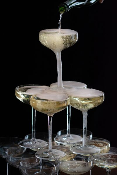 Pouring sparking wine into a DIY Champagne Tower