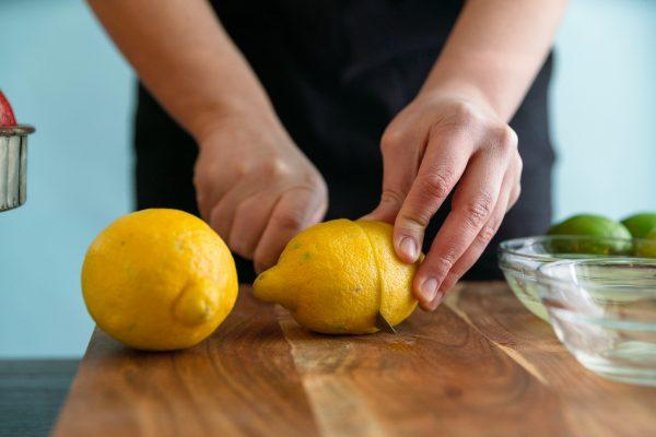 Cutting a lemon in half