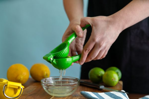 Juicer squeezing a lime