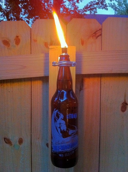 Beer Bottle Torch from Metal and Mud