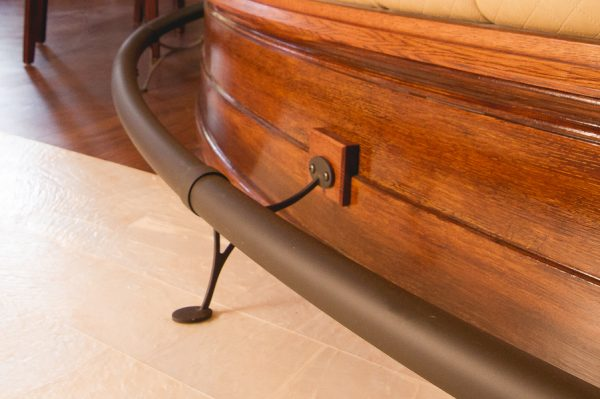 Closeup of stylish combination bar foot rail brackets