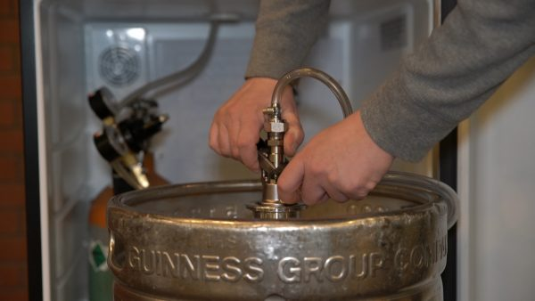 Step 6: Attach coupler to Guinness keg.