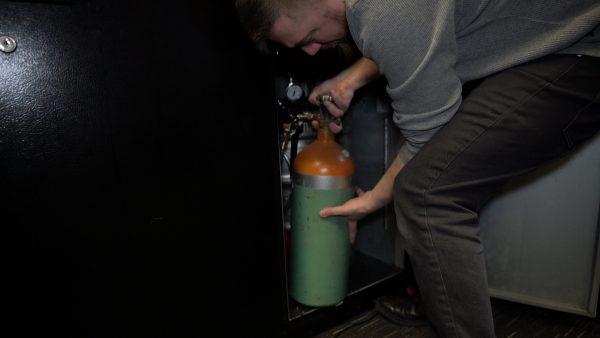 Step 10: Carefully place air tank in kegerator fridge.