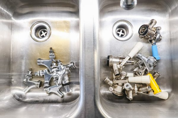 Coupler and faucet parts for draft beer system being cleaned