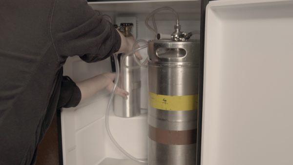 Step 12- Carefully place CO2 tank in kegerator fridge.