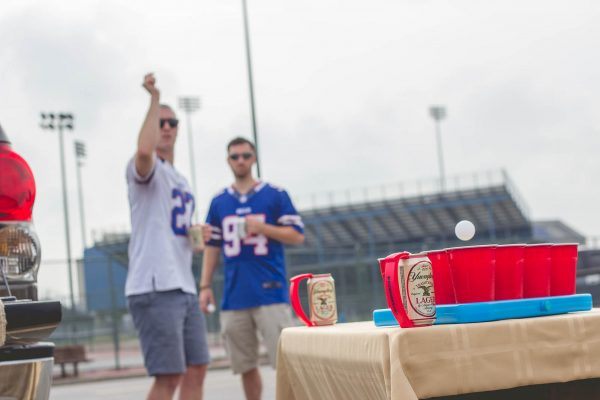 Bills fans play beer pong at a tailgate