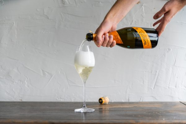 Pouring a glass of Prosecco
