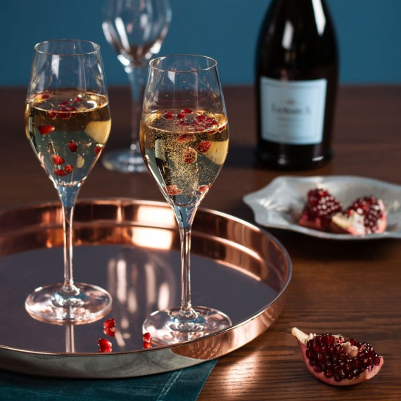 Sparkling wine glasses filled with Prosecco and fruit