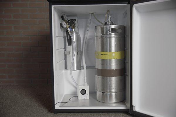 A Super Tower Cooler inside a kegerator fridge