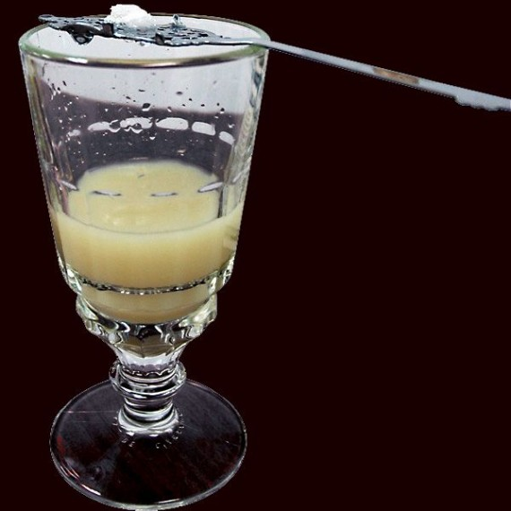 An absinthe spoon and specially designed glass are used to louche absinthe.