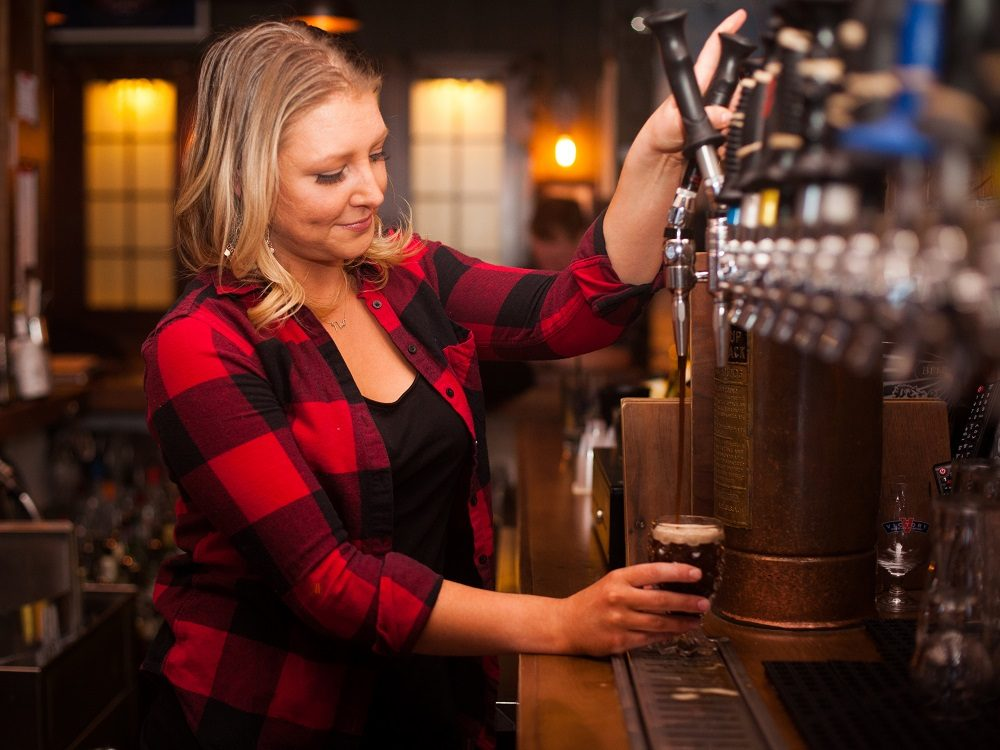 sarah pouring beer