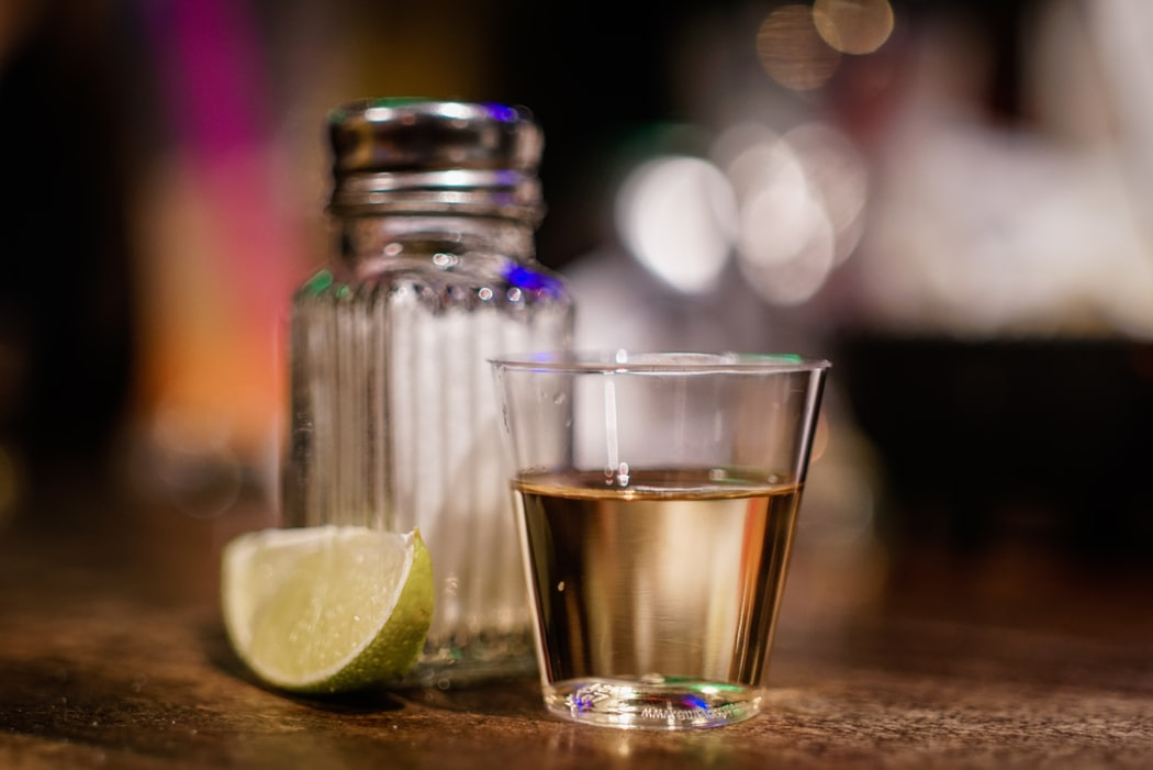 tequila shot with salt and lime wedge