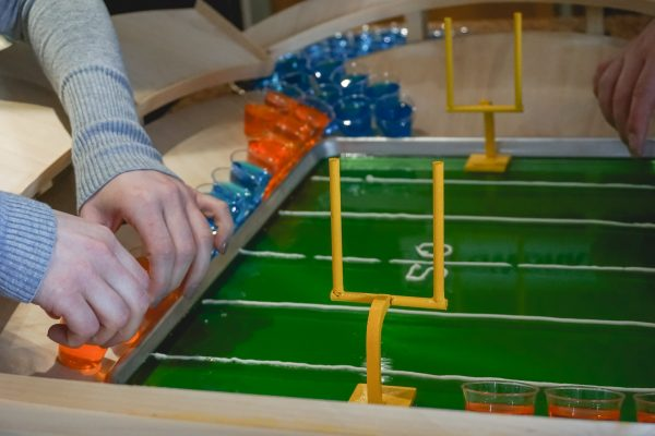 assembling a jello shot football snack stadium