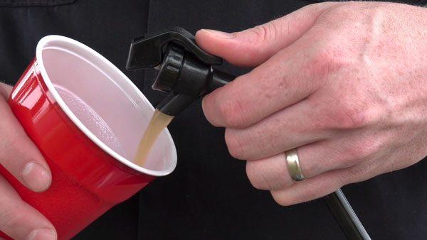 beer flowing from keg tap