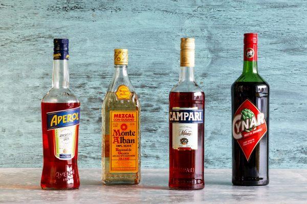 Aperol, Mezcal, Campari and Cynar Liquor Bottles