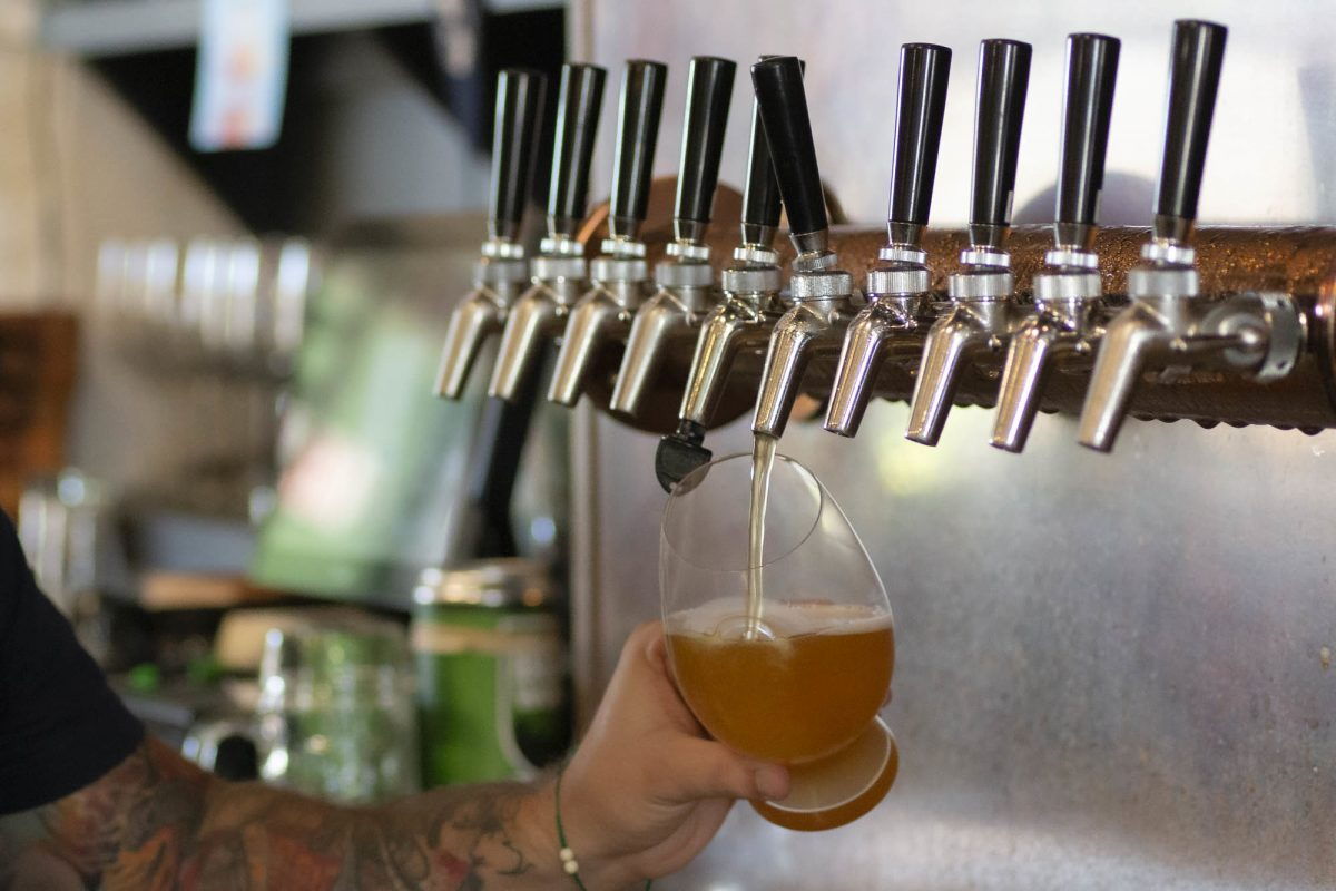 Pouring draft beer from a tap