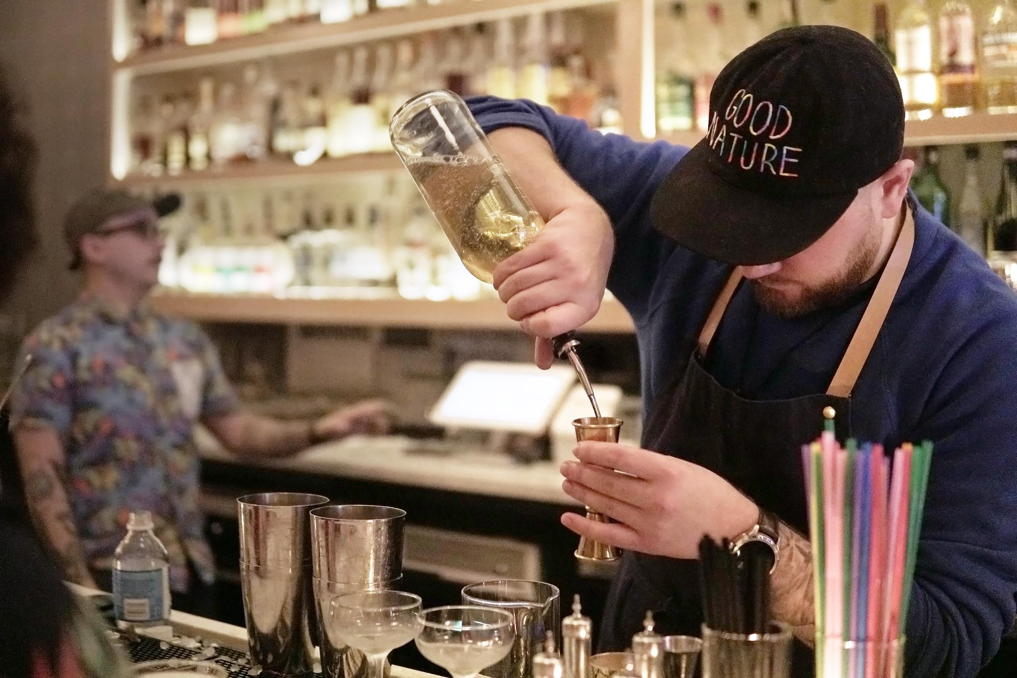 bartender filling a jigger