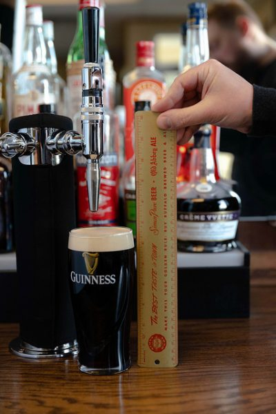 """The standard busy bartender pour produced a beer head size of exactly 14/16""""."""