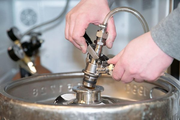 A TOF U-system keg coupler, which is required for pouring Guinness on tap.